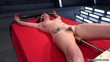 Tied up ankles to a wooden chair solo hottie takes fast fucking machine
