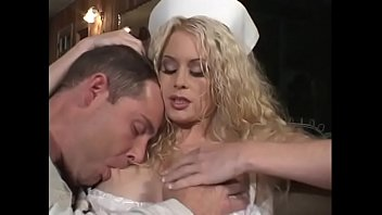 Blonde with huge breasts Victoria Givens changed into a doctor's gown and sucks on the couch