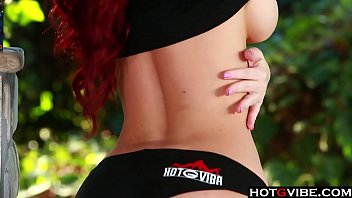 Hot redhead plays with herself