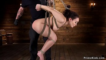 Brunette slave in bent over...