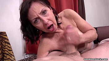 Mom Danina catches handsome guy jerking off and gives him a blowjob.