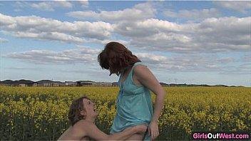 Natural lesbian girls on a canola field
