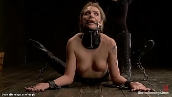 Gagged blonde Dahlia Sky is bound on the floor in ballet boots then in back bend position in latex stockings gets tickled with small spur in hands of lezdom Claire Adams