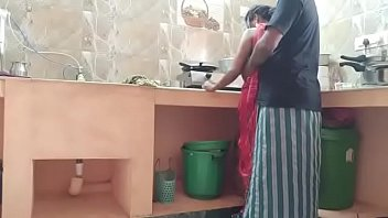 man and wife having sex in the kitchen