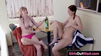 Busty hairy lesbian Laney enjoys oral sex outside