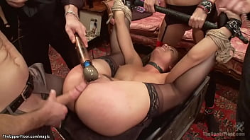 Tall blonde slave Amanda Tate and petite brunette Roxanne Rae are bound in lingerie and humiliated and rough fucked at bdsm Brunch party in the Upper Floor