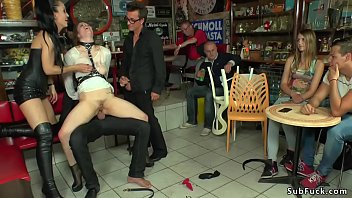 Mistress Fetish Liza in tight leather skirt and top disgraces and dominates busty brunette Euro slut Lucia Love in public street