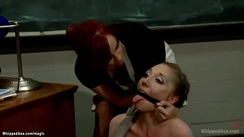 Big boobs redhead MILF professor Bella Rossi makes cheating lesbian student Emma Haize rimming her then with strapon anal fucks her in the office