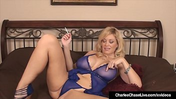 Busty Mature Mommy Charlee Chase, puffs on a cigarette while sticking her fingers inside her moist muff until she reaches her orgasm!