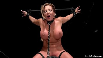 Brunette Milf slave with huge tits Richelle Ryan in metal device bondage with ass sticked back and in the air in doggy position gets toyed
