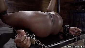 Small tits ebony slave Anna Foxxx shackled to a wooden wall gets hard whipped then master whips her ass while she is bend over in metal device
