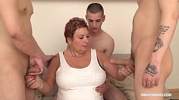 Grandma with huge tits get her face fucked by three young studs
