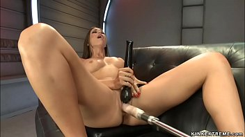Stunning busty long legged solo brunette babe Rilynn Rae masturbates with black Magic Wand and fucks machines in various positions and bondage