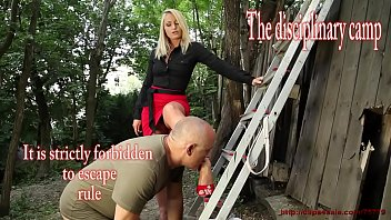This is a  camp for the girls who made some crime  and they are here for changing. When the Mistress talk,  there are the guards with her.