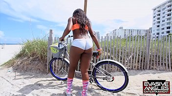 EVASIVE ANGLES Cute ebony babe rides a bike and a dick