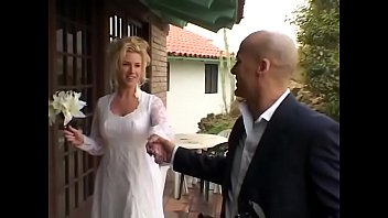 Beautiful blonde bride with big boobs enjoys to feel cameraman's hard dick stiffed in her ass