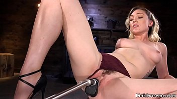 Sexy blonde solo babe Lily LaBeau with natural nice pair of tits and sexy ass gets fucked by different machines in dark dungeon room