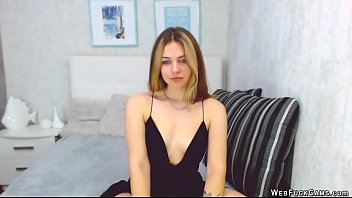 Blonde amateur babe in black dress posing on webcam then stripping and fingering her wet pussy in various positions in bedroom in live show