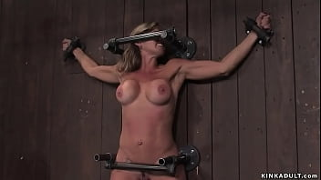 Fake big boobs MILF Felony is bound to the wooden wall in the air with sticked vibrator between her legs and nipples pinned by master Matt Williams