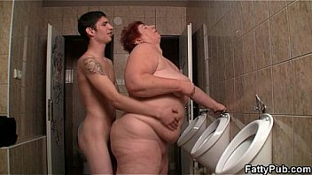 Slim guy screws huge bitch in the restroom