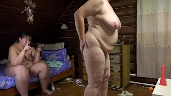 Lesbians behind the scenes in front of a webcam. Mature bbw fulfill the request of a stranger, demonstrate juicy booty, big tits and fuck a hairy cunt.