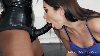Brunette girl gets fucked with a strap-on by her ebony friend