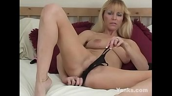 Horny blonde milf babe from Yanks Nicole Moore masturbating her pussy to orgasm