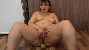 Hairy vagina plays with a big apple Chubby milf fisting herself fingering the clit and showing her gaping pussy