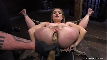 Blonde slave beauty Katie Kush in full legs split suspension gets hard whipped by master The Pope then fucked with dildo on a stick on hogtie