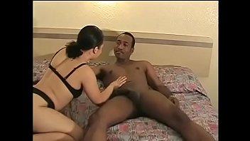 A modest brunette with a big ass sucks a big black cock and gets cum on her face