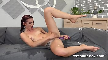 You'll love to see this total babe piss into a big glass and soak her face and hair with her piss, before pissing again, this time all over herself and fucking herself with a purple dildo!