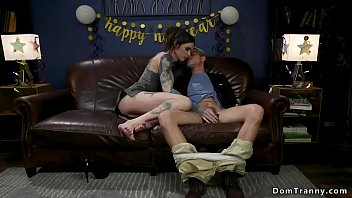 Watch Tattooed brunette shemale lady celebrating New Years Eve with blond man and then anal fucks him while he_wearing red socks preview