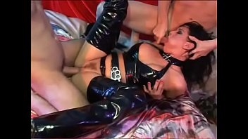 Dark-haired beauty Tory Lane in black latex outfit explains couple of stallions the best way they can use their masive dongs