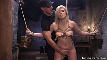 Pretty blonde slut Rikki Rumor with clamped nice pair of tits in threesome bdsm training gets mouth and pussy banged