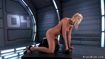 Shaved pussy blonde sitting in armchair with spreaded legs and masturbating