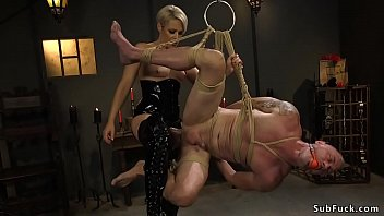 Blonde Milf mistress Helena Locke in rubber lingerie puts her male slave D Arclyte in rope and makes him lick in face sitting