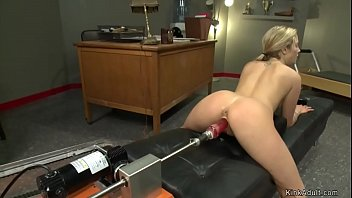 Naked athlete blonde Karla Kush straddling leather ottoman and getting red dildo fucking machine in her pussy then on a table fucking and squirting
