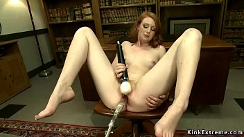 Watch Tight pussy solo ginger Nathalie Lawson laying on table and through spreaded legs shoves big dick fucking machine while vibrates clit preview