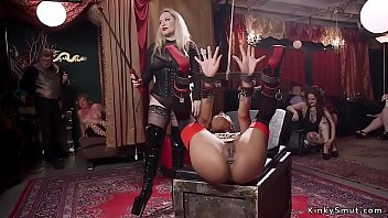 Hot busty ginger slave in rope bondage with two vibrators on her clit tormented at orgy bdsm party