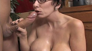 Big breasted mom strokes a black cock