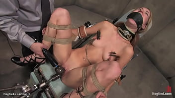 Brunette slut Calico is strapped in insane room in the hospital by nurse then machine fucked by doctor till suspended in upside down position