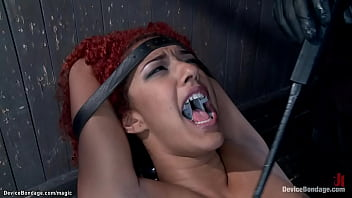 Bound redhead ebony slave Daisy Ducati gets naked body clamped and tazappered then ass hooked and tied to hair by master The Pope on device bondage