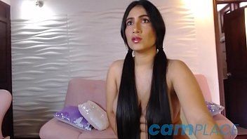 MarieJane, long hair brunette cam model sucks a dildo and plays with her vagina