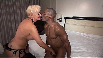 Watch this muscular black mature gentleman pleasure a Queen of Spades Blonde black cock slut