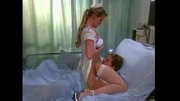 Gorgeous blonde nurse Nina Ferrari prepares patient for taking part in experimental trisl