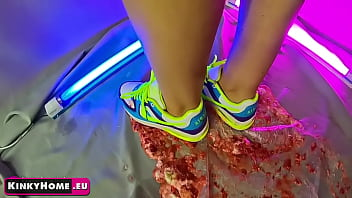 The girl crushes the strawberries with sneakers NIKE AIR