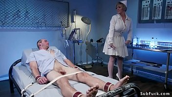 Blonde Milf nurse Dee Williams with natural huge tits clamps nipples and balls to tied male patient Jonah Marx then measures his blood pressure Thumbnail