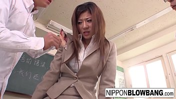Asian babe sucks cock