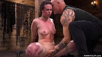 Baldheaded tattooed master Derrick Pierce rubbing pussy to bound brunette slave Casey Calvert while she is squating then whipping and fucking her