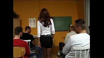 Sexy teacher in black stockings sucks student dicks in class